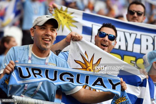 Uruguay fans cheer before the start of the Russia 2018 World Cup Group A football match between Uruguay and Russia at the Samara Arena in Samara on...