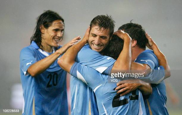 Uruguay football players celebrate a goal during an international friendly football match between Uruguay and China at Wuhan Sports Center Stadium on...