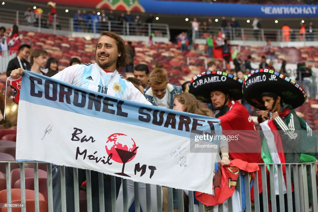 Uruguay, left, and Mexico soccer fans attend the opening match of the FIFA World Cup between Russia and Saudi Arabia at the Luzhniki stadium in Moscow, Russia, on Thursday, June 14, 2018. President Vladimir Putin has spent six years and more than $11 billion preparing nearly a dozen Russian cities to host the soccer World Cup, the biggest such event the countrys held since the collapse of the Soviet Union. Photographer: Andrey Rudakov/Bloomberg via Getty Images