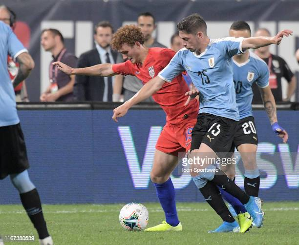Uruguay midfielder Federico Valverde and USA forward Josh Sargent compete for the ball during an exhibition soccer match between the US Mens National...