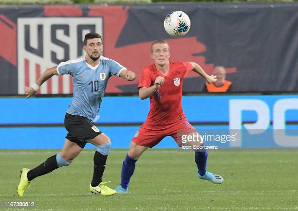 Uruguay midfielder Giorgian De Arrascaeta and USA midfielder Jackson Yueill compete for the ball during an exhibition soccer match between the US...
