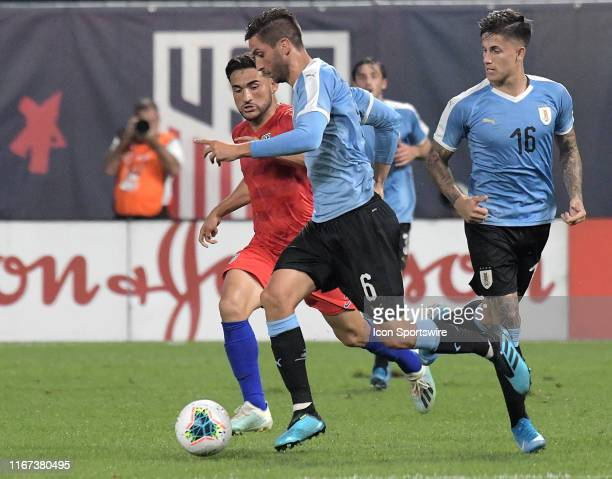 Uruguay midfielder Rodrigo Bentancur and USA forward Jordan Morris compete for the ball during an exhibition soccer match between the US Mens...