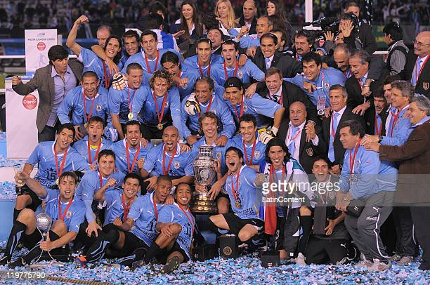 Uruguay National Team poses with the trophy of the Copa America 2011 after their victory against Paraguay at Antonio Vespucio Liberti Stadium on July...