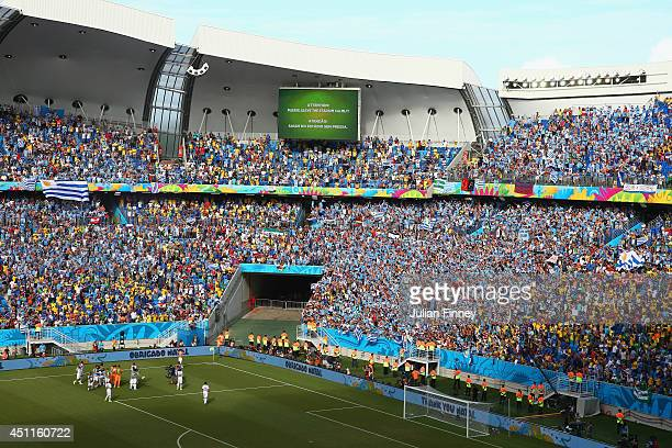 Uruguay players celebrate in front of fans after the 2014 FIFA World Cup Brazil Group D match between Italy and Uruguay at Estadio das Dunas on June...