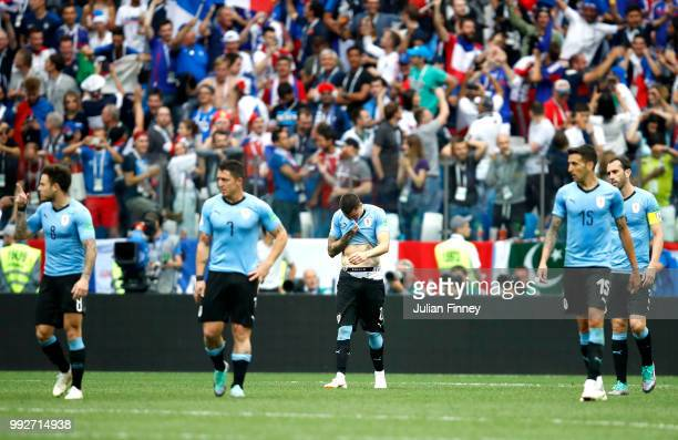 Uruguay players look dejected following France scoring their second goal during the 2018 FIFA World Cup Russia Quarter Final match between Uruguay...