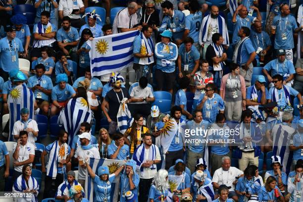 Uruguay supporters cheer ahead of the Russia 2018 World Cup quarterfinal football match between Uruguay and France at the Nizhny Novgorod Stadium in...