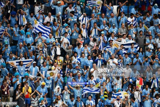 Uruguay supporters cheer during the Russia 2018 World Cup quarterfinal football match between Uruguay and France at the Nizhny Novgorod Stadium in...