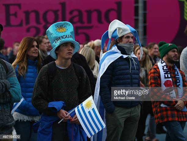 Uruguay supporters watch the Wales v Australia match on a giant screen outside the stadium ahead of the 2015 Rugby World Cup Pool A match between...