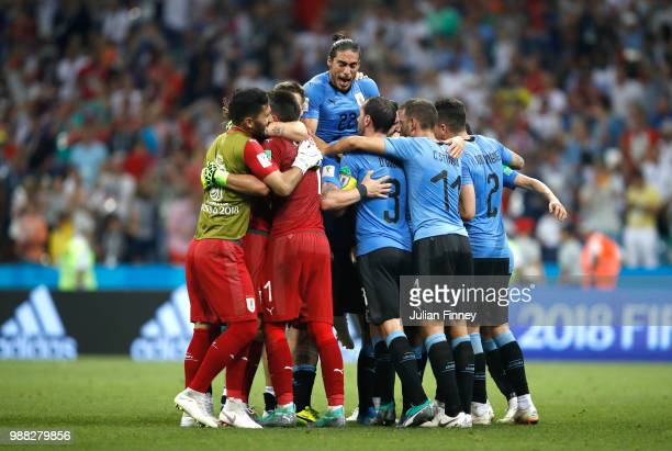 Uruguay team celebrate celebrate their victory following the 2018 FIFA World Cup Russia Round of 16 match between Uruguay and Portugal at Fisht...