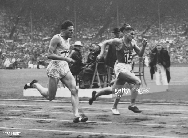 Uruguayan athlete Juan Lopez , Brazilian athlete Ivan Hausen compete in heat 11 of the men's 200 metres event at the 1948 Summer Olympics, at the...