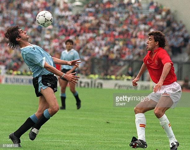 Uruguayan captain and midfielder Enzo Francescoli controls the ball with his chest in front of a Spanish player during the World Cup first round...