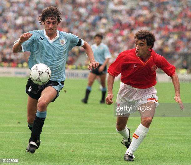 Uruguayan captain and midfielder Enzo Francescoli eyes the ball as he tries to outrun a Spanish player during the World Cup first round soccer match...