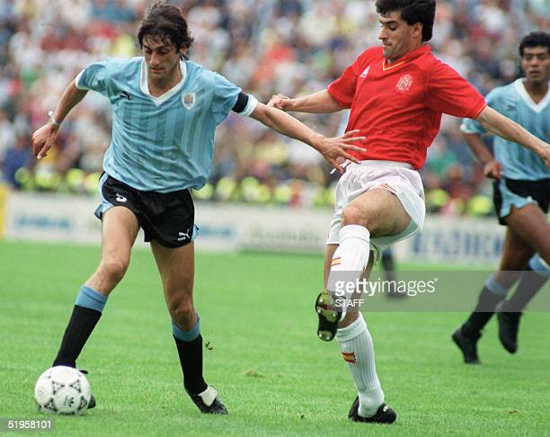 Uruguayan captain and midfielder Enzo Francescoli tries to dribble past a Spanish player during the World Cup first round soccer match between...