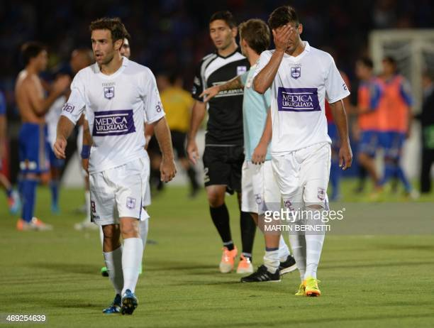 Uruguayan Defensor Sporting's players leave a field after their Libertadores Cup football match against Universidad de Chile at the National stadium...