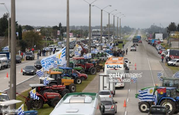 Uruguayan farmers and truck drivers demonstrate against insecurity and taxes along route 1 in Rafael Perazza west of Montevideo on June 11 2018...