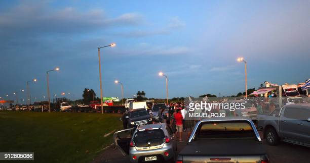 Uruguayan farmers and truck drivers hold a vigil on January 31 2018 outside the town of Progreso in Canelones department 35 km from Montevideo...