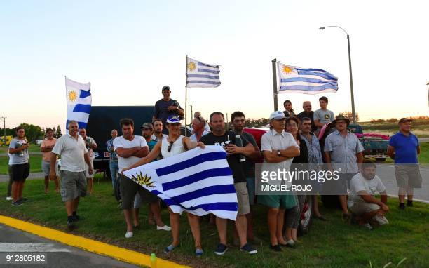 Uruguayan farmers hold a vigil on January 31 2018 outside the town of Progreso in Canelones department 35 km from Montevideo demanding tax relief as...