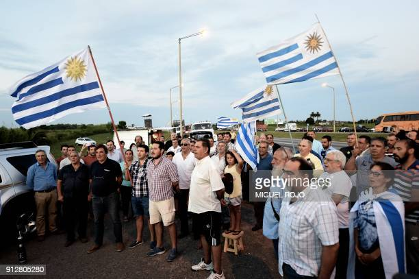Uruguayan farmers sing the national anthem as they hold a vigil on January 31 2018 outside the town of Progreso in Canelones department 35 km from...