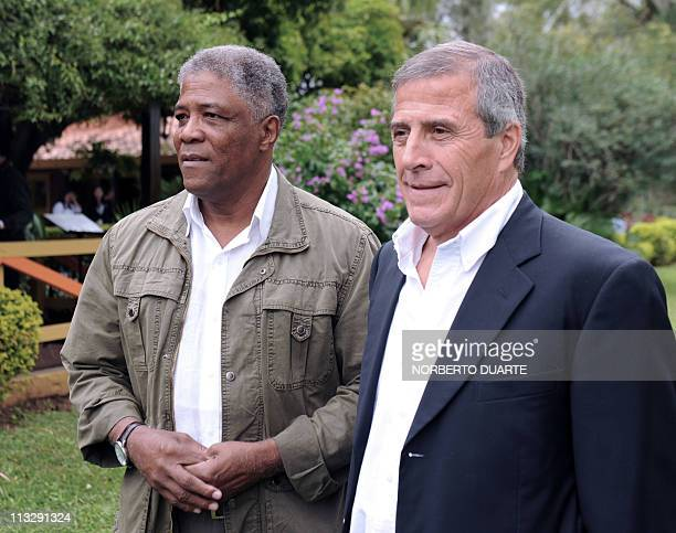 Uruguayan football coach Oscar Tabarez poses alongside Colombian former footballer and coach Francisco Maturana during a reception on April 30 2011...