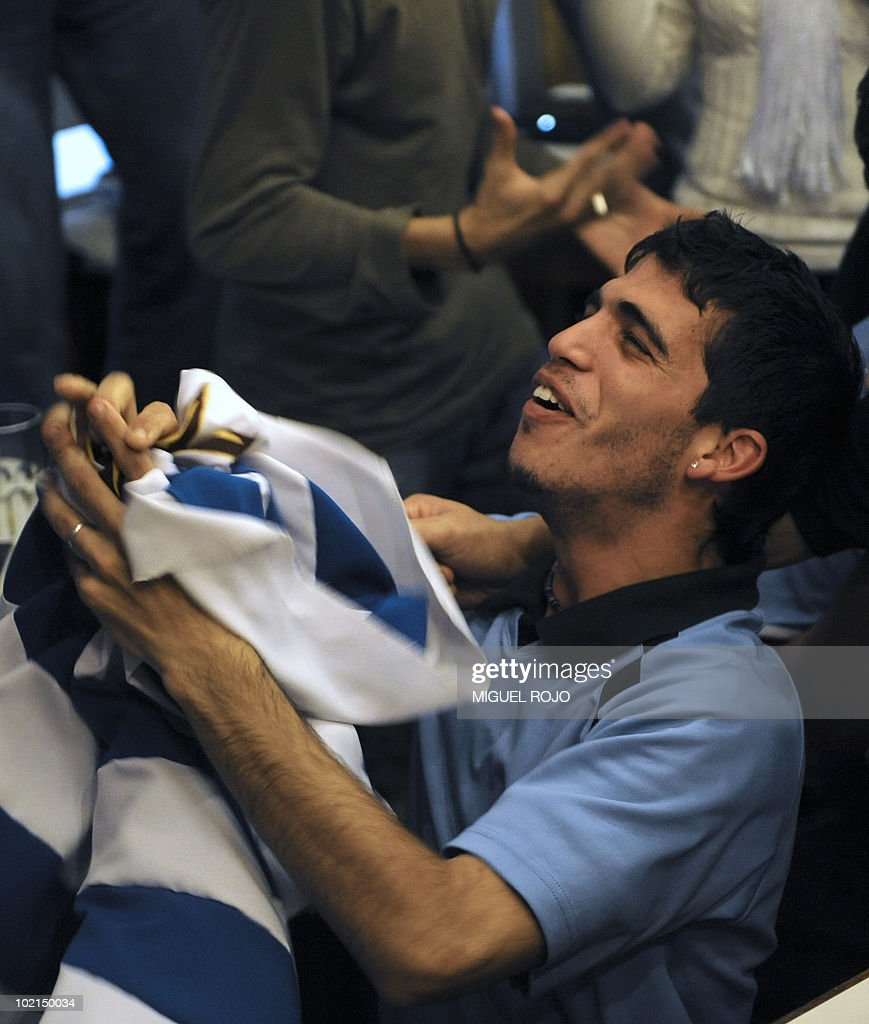 Uruguayan football fans celebrate as the