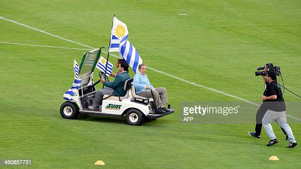 Uruguayan football legend Alcides Ghiggia is driven into the field before the start of the Brazil 2014 FIFA World Cup intercontinental playoff second...