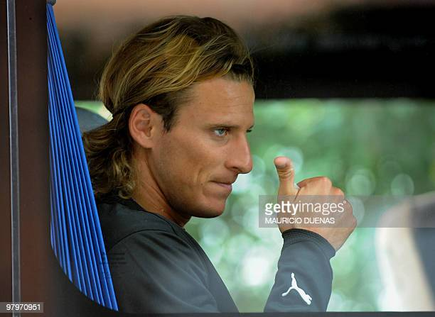 Uruguayan footballer Diego Forlan gives the thumbs up to the fans prior to a training session on September 5 2008 in Bogota Uruguay arrived in Bogota...