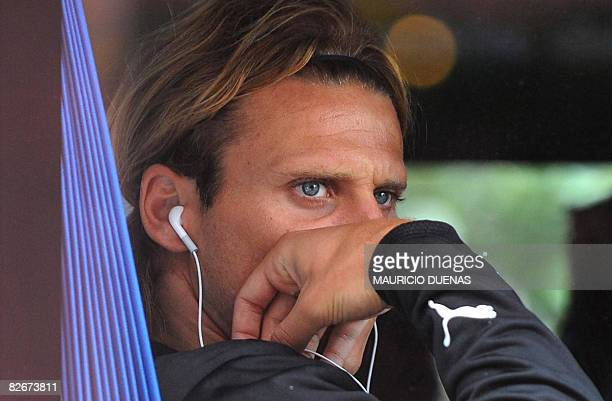 Uruguayan footballer Diego Forlan looks through a bus window prior to a training session on September 5 2008 in Bogota Uruguay arrived in Bogota...