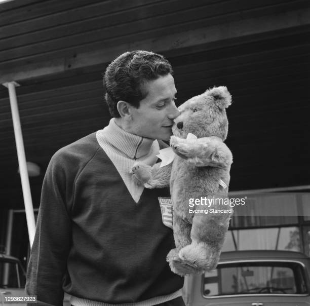 Uruguayan footballer Horacio Troche with a teddy bear during the World Cup in England, 11th July 1966.