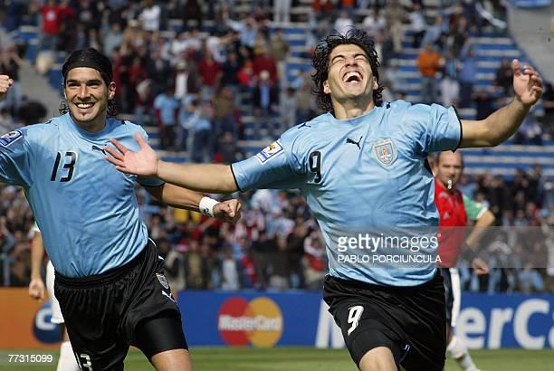 Uruguayan footballer Luis Suarez jubilates next to teammate Sebastian Abreu after scoring against Bolivia during their FIFA World Cup South...