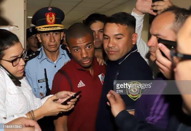 Uruguayan footballer Nicolas De la Cruz player of Argentina's River Plate arrives under escort at the Court of Justice in Asuncion on August 28 a day...
