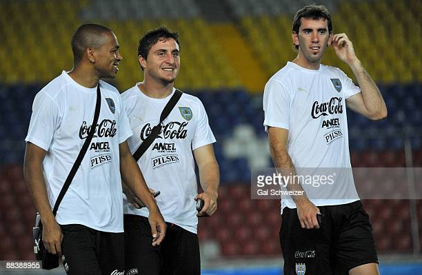 Uruguayan footballers Diego Godin Cristian Rodriguez and Alvaro Pereria joke during a visit to the Cachamay stadium on June 09 2009 in Puerto Ordaz...