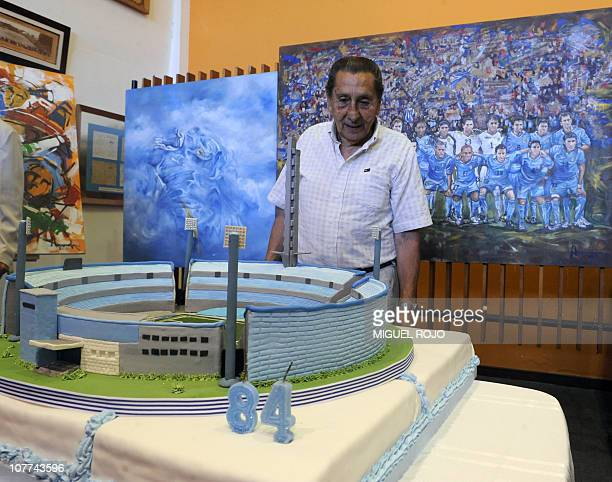 Uruguayan former football player Alcides Edgardo Ghiggia looks at his birthday cake during an homage at the Football Museum in Montevideo on December...