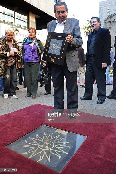 Uruguayan former footballer Alcides Ghiggia poses after being honored with a Sun in the Walk of Fame of Montevideo inaugurated on April 28 2010 AFP...