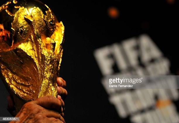 Uruguayan former soccer player Alcides Edgardo Ghiggia carries the FIFA World Cup Trophy during and event of presentation as part of the FIFA World...