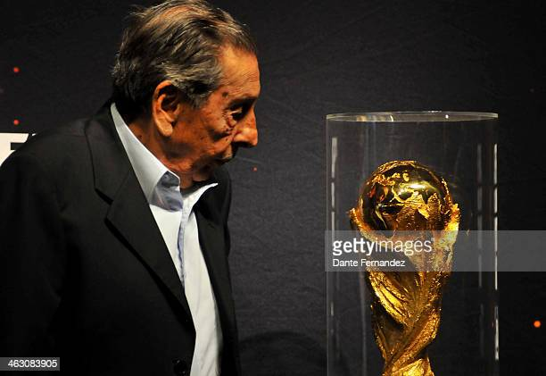 Uruguayan former soccer player Alcides Edgardo Ghiggia poses for a photo beside the FIFA World Cup Trophy during and event of presentation as part of...