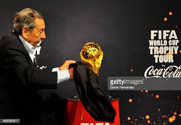 Uruguayan former soccer player Alcides Edgardo Ghiggia unveils the FIFA World Cup Trophy during and event of presentation as part of the FIFA World...