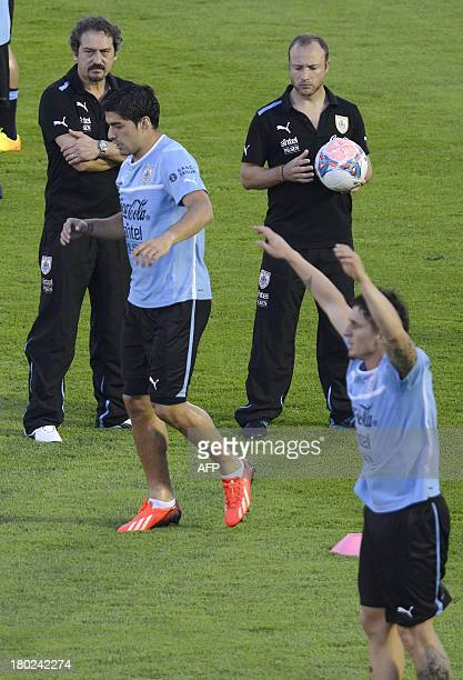 Uruguayan forward Luis Suarez and midfielder Cristian Rodriguez warmup before their Brazil 2014 FIFA World Cup South American qualifier match against...