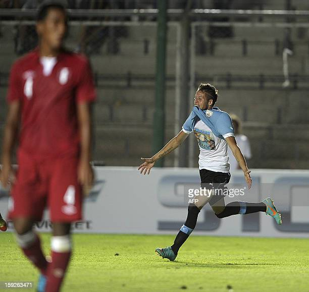 Uruguayan forward Nicolas Lopez celebrates after scoring against Peru during their South American U-20 Championship Group B football match at...