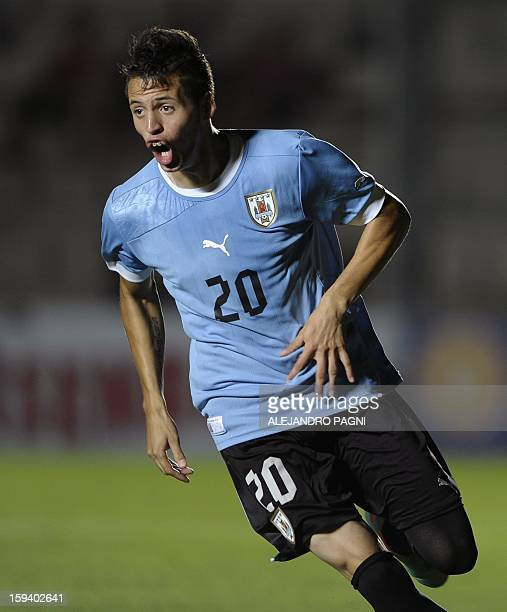Uruguayan forward Nicolas Lopez celebrates after scoring his team's third goal against Brazil during their South American U-20 Championship Group B...