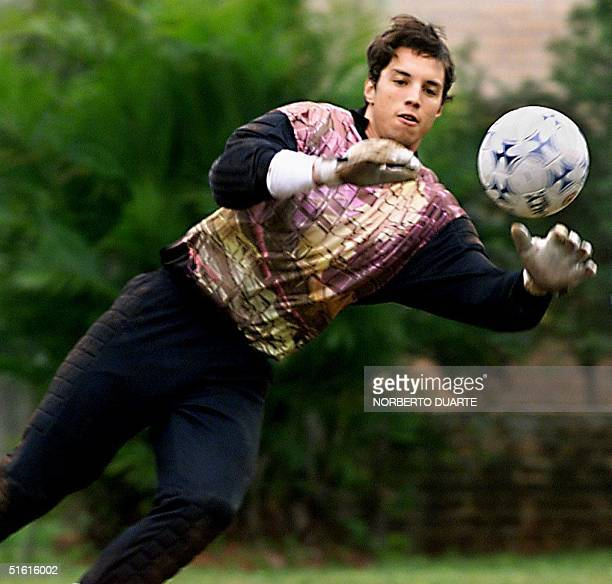 Uruguayan goakeeper Fabian Carini makes a stop 16 July during a practice session in Luque Paraguay Uruguay will face Brazil 18 July in the final of...