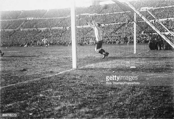 Uruguayan goalkeeper Enrique Ballesteros is beaten by Carlos Peucelle for Argentina's first goal in the FIFA World Cup Final between Uruguay and...
