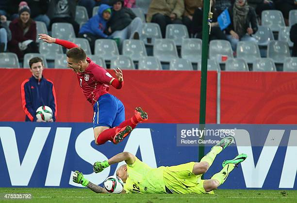 Uruguayan goalkeeper Gaston Guruceaga, makes a save to deny Ivan Saponjic of Serbia during the FIFA U-20 World Cup New Zealand 2015 Group D match...