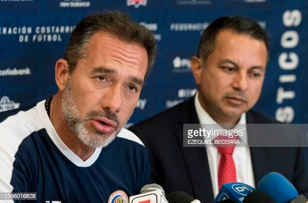 Uruguayan Gustavo Matosas head coach of Costa Rica's national football team speaks next to the president of the Costa Rican Football Federation...