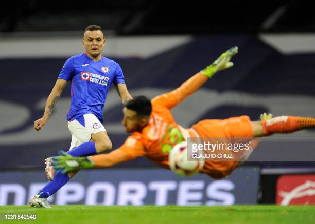 Uruguayan Jonathan Rodriguez of Cruz Azul scores against Atlas during their Mexican Clausura football tournament match at the Aztec stadium in Mexico...