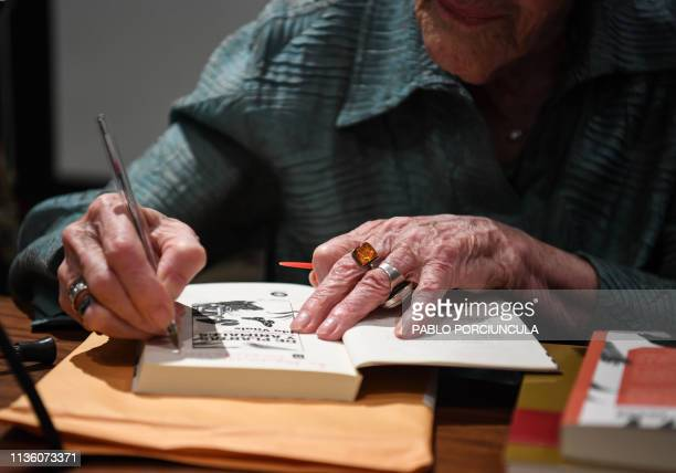 Uruguayan laureate poet Ida Vitale signs copies of her new book De plantas y animales acercamientos literarios during its presentation at the...