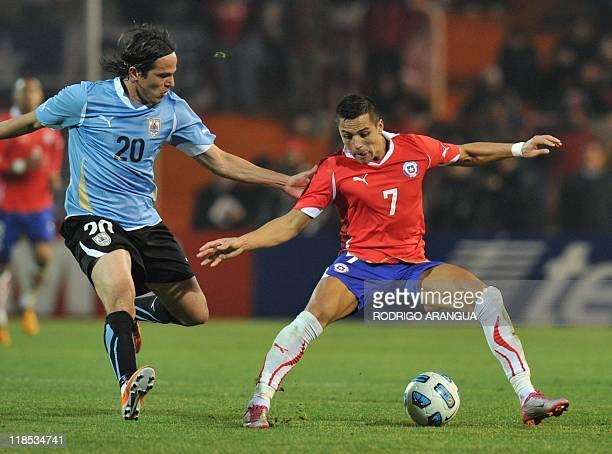 Uruguayan midfielder Alvaro Gonzalez marks Chilean forward Alexis Sanchez during the 2011 Copa America Group C first round football match against...