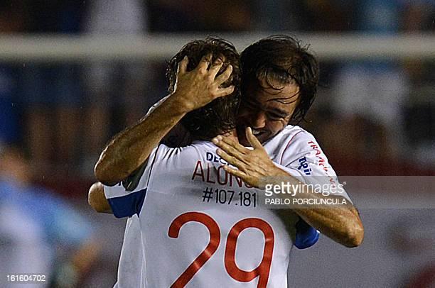 Uruguayan Nacional footballer Alvaro Recoba hugs Ivan Alonso, celebrating the latter's goal against Ecuador's Barcelona team during the Libertadores...