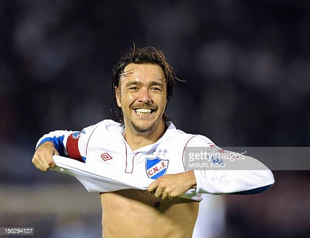Uruguayan Nacional's player Alvaro Recoba celebrates the third goal against Chilean Iquique during their Copa Sudamericana football match at the...