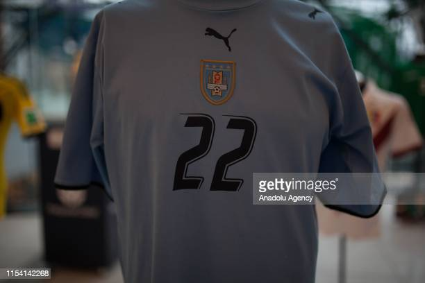 Uruguayan national team player Edinson Cavani's jersey is shown during the San Siro jersey museum exhibition in Bogota Colombia on July 05 2019 An...