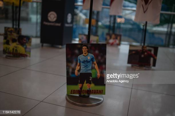 Uruguayan national team player Edinson Cavani's photo is shown during the San Siro jersey museum exhibition in Bogota Colombia on July 05 2019 An...